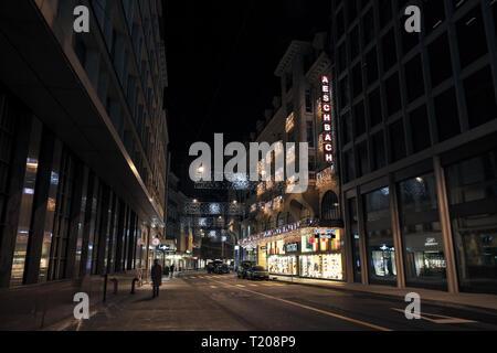Geneva, Switzerland - November 24, 2016: Rue du Rhone. Night cityscape of Geneva city - Stock Photo