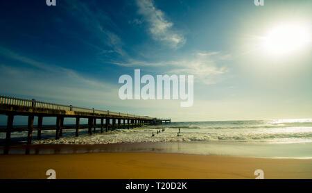 Stunning view of sunset beach bridge silhouette - Stock Photo