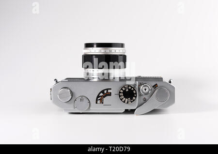 Old used dirty old-fashioned film photocamera - Stock Photo