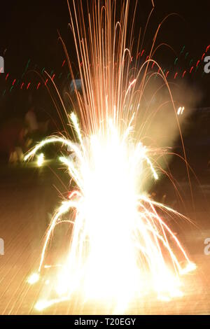 Dazzling sparkles from fire cracker during Diwali festival - Stock Photo