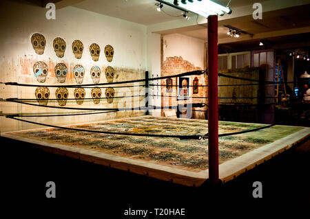 Wrestling ring with Skulls in the background - Stock Photo