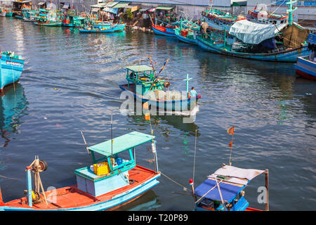 Traditional Vietnamese fishing boats tied up at the harbour at Dinh Cau, Phu Quoc island, Vietnam, Asia - Stock Photo