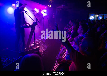 Killers Guitarist, Dave Keuning performing in Glasgow to a packed crowd at the renowned King Tuts Wah Wah Hut in Glasgow. - Stock Photo