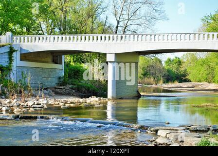 overpass over a stream in a rural town - Stock Photo