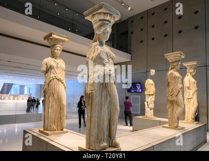 The original Caryatids from the Temple of the Erechtheion on the Acropolis now displayed in the new Acropolis Museum,  designed by architect Bernard T - Stock Photo