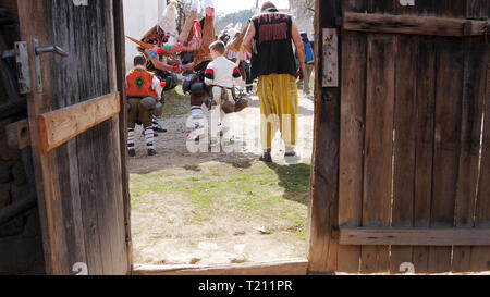 Turia, Bulgaria, 9 March 2019. Masquerade ritual Kukeri  to expel evil.  People from the village wear big bells and terrible costumes. - Stock Photo