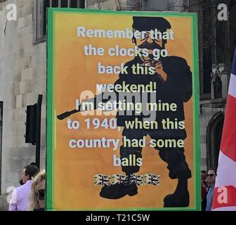 London, UK. 29th Mar, 2019. Brexit supporters demonstrate with a 'March to leave' for Britain's withdrawal from the EU. Among other things, they carry a poster with a man with a rifle and the inscription 'Remember that the clocks will be reset this weekend! I'm putting mine back to 1940, when the country still had eggs.' The protest march, which began on 16 March in Sunderland, North East England, ends on 29 March in Parliament Square, the day on which Brexit was originally scheduled to take place. Credit: Silvia Kusidlo/dpa/Alamy Live News - Stock Photo