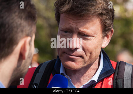 London, UK. 29th March, 2019. Richard Tice, founder of Leave Means Leave and former co-chair of Leave.EU, joins other pro-Brexit activists from Leave Means Leave marching from Fulham to a rally in Parliament Square in Westminster on the final leg of the March to Leave on the day on which the UK was originally to have left the European Union. The March to Leave was organised by Leave Means Leave, with assistance from Nigel Farage, as a peaceful protest 'to demonstrate the depth and breadth of popular discontent with the way Brexit has been handled' by the Government. - Stock Photo