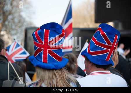 London, United Kingdom. 29th Mar, 2019. Two Pro-Leave supporters with union flag hats attending a Pro-Leave rally near Parliament Square. Credit: Sandip Savasadia/Alamy Live News - Stock Photo