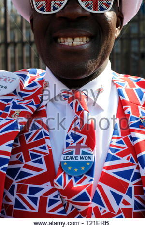 Brexitland - 'In The Teeth Of Brexit' - A Brexit Vote Leave supporter outside Westminster, Brexit Day 1.0, Meaningful Vote 2.5, Westminster London, UK. Britain 29th Mar 2019. Credit: BrexPics/Alamy - Stock Photo