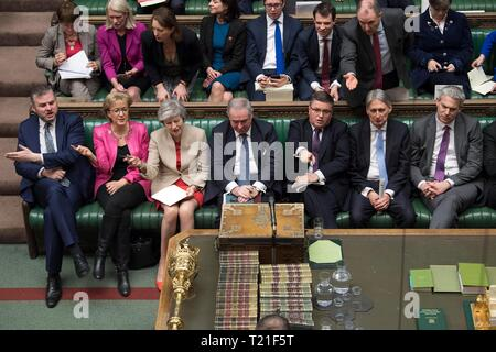 London, Britain. 29th Mar, 2019. British Prime Minister Theresa May (3rd L, Front) attends the debate in the House of Commons in London, Britain, on March 29, 2019. British lawmakers on Friday voted to reject Prime Minister Theresa May's Brexit deal, which has already been rejected twice in Parliament since January. Credit: UK Parliament/Mark Duffy/Xinhua/Alamy Live News - Stock Photo