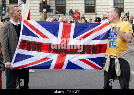 London, UK. - March 29, 2019: A flag and message held at a demonstration in Parliament Square on the day the UK should have left the EU. Credit: Kevin J. Frost/Alamy Live News - Stock Photo