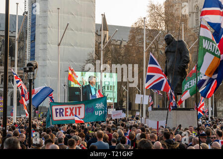Westminster, London, UK. Demonstrations took place by Brexiteers protesting against the UK government's inability to follow through with leaving the European Union despite the referendum result. On the day that a Brexit motion took place in Parliament large numbers of people gathered outside to make their point heard. Churchill statue - Stock Photo