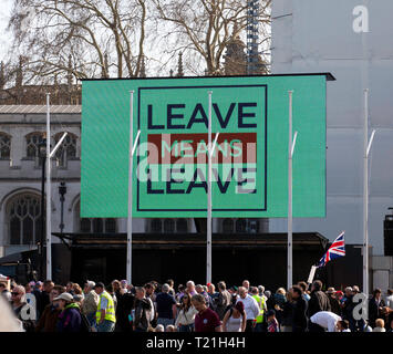A giant screen displays a message 'Leave means Leave', in Parliament square, as part of a large Pro-Brexit demonstration. - Stock Photo