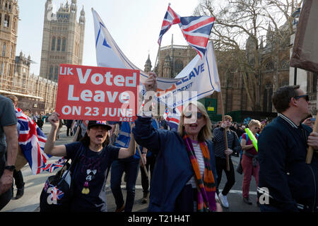 Protestors marching  outside Parliament to demonstrate against the delay to Brexit  on the day the UK should have left  the EU