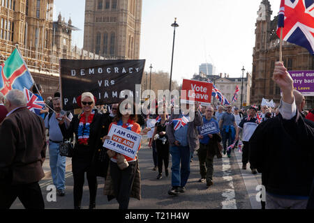 Protestors matching by the Houses of Parliament to demonstrate against the delay to Brexit  on the day the UK should have  left  the EU