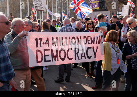 Protestors  with banners, gather outside Parliament to demonstrate against the delays  to Brexit  on the day the UK should have left  the EU