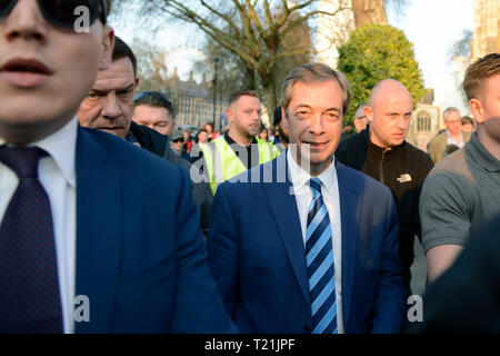 Former UKIP leader Nigel Farage seen leaving the Leave means leave   stage in Parliament Square after addressed a speech to his supporters.  A Leave means leave pro Brexit march begun on March 16 in Sunderland, UK and ended with a rally in Parliament Square on March 29 in London, same day that UK has been scheduled to leave the European Union. Pro Brexit protesters gathered at Parliament Square to demand from the government to deliver what was promised and leave the European Union without a deal. Nigel Farage and Tommy Robinson were seen giving speeches to their supporters in different stages  - Stock Photo