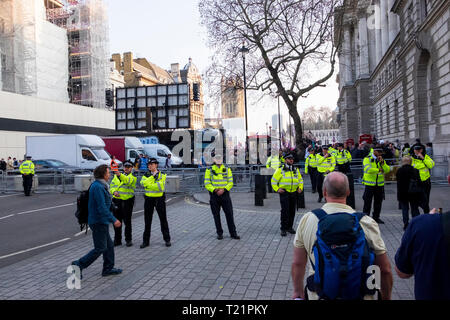 London, UK. 29th March 2019, the day the UK was due to leave the EU. There was some trouble later outside Downing Street but earlier at 5pm secure police cordons restricted access along Whitehall in both directions creating a sterile zone.  Credit: Scott Hortop/Alamy Live News. - Stock Photo