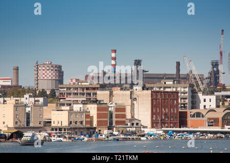 Taranto steel plant on the sea side very close to the old city of Taranto - Stock Photo