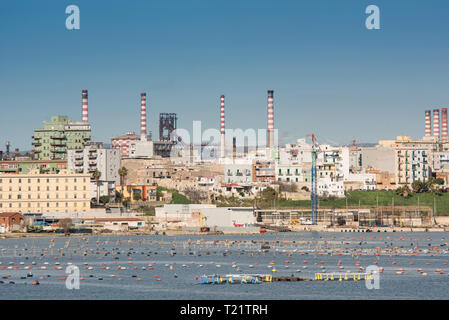 Panorama of Steel plant industry on the sea side very close to the old city of Taranto, Puglia. Italy - Stock Photo