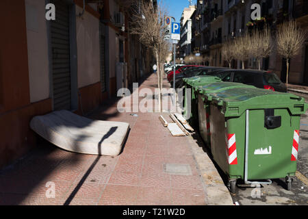 Dirty street, road and footpath full of garbage - Stock Photo