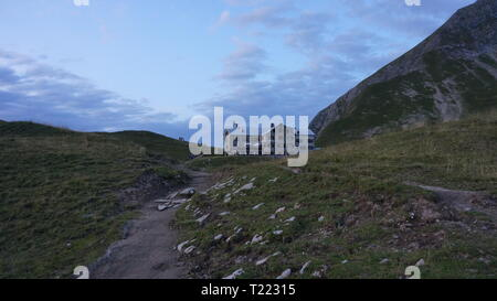 hiking in the alps in summer - Stock Photo