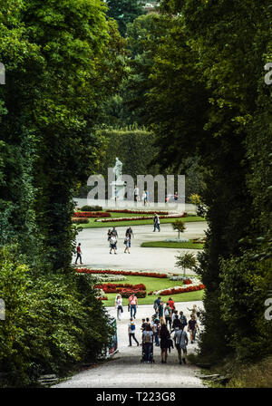Vienna, Austria, September , 15, 2019 - : Tourists walking at the gardens of Schonbrunn Palace , a former imperial summer residence of Habsburg - Stock Photo