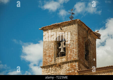 Close-up of the gothic San Martin Church bellow tower in a sunny day at Trujillo. Birthplace town of the Conquistador Francisco Pizarro in Spain. - Stock Photo