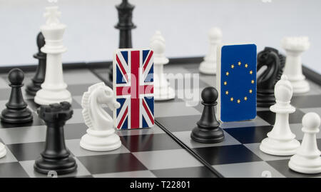 Chess pieces and flags of the European Union and the UK on a chessboard. The concept of the political game and chess strategy Brexit - Stock Photo