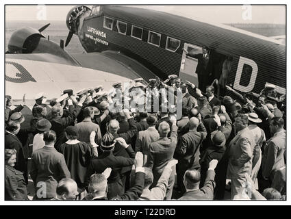 Vintage 1930's pre-war B&W image of Hermann Göring leading German Nazi and head of the German Luftwaffe arriving in Hungary 'Mátyásföldön' in a German Junkers Ju 52 with 'Lufthansa' insignia on fuselage Crowd greet him with Heil Hitler salutes 1935 - Stock Photo