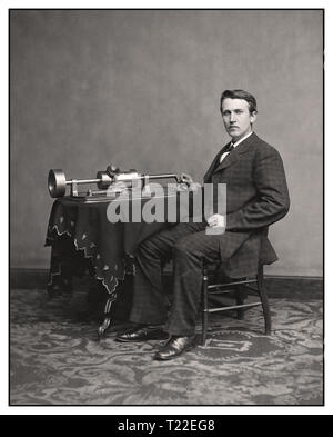 "Thomas Edison and his early phonograph. circa 1877 ""Thomas A. Edison."" On Nov 21, 1877, Thomas Edison introduced his phonograph machine to the world, a brilliant device to record and playback sound. The sound vibrations of his voice would be indented onto the cylinder by the recording needle.. - Stock Photo"