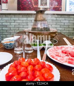 A traditional Chinese hotpot with meat and condiments. Food photography - Stock Photo
