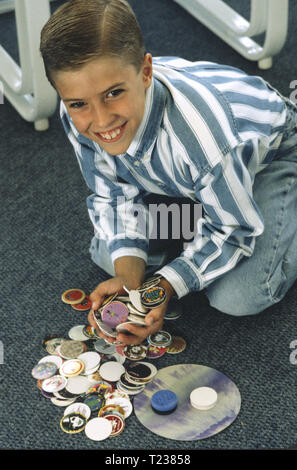 7 Year Old Boy Collecting Milk Pogs, USA - Stock Photo