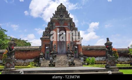 The gate of Pura Taman Ayun Temple in Bali, Indonesia. - Stock Photo