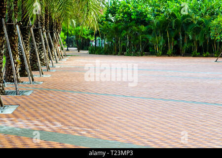 pattern of brick wall on paving floor near playground in public park - Stock Photo