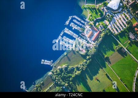 Germany, Bavaria, Chiemgau, Aerial view of Lake Chiemsee, Prien, harbour, swimming bath - Stock Photo