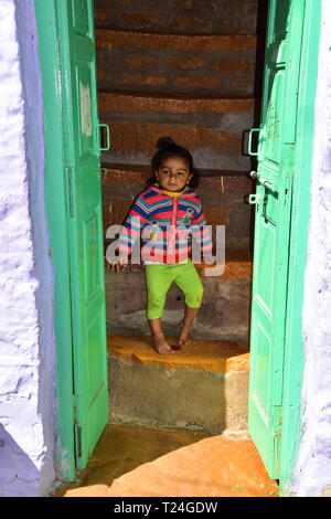 Cute Indian Girl on stairs, Jaisalmer Fort, Jaisalmer, Rajasthan, India - Stock Photo