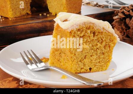 A slice of orange or pumpkin bundt cake - Stock Photo