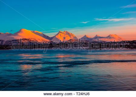 Winter landscape along the coastline near Tromso, Arctic, Northern Norway at sunrise. - Stock Photo