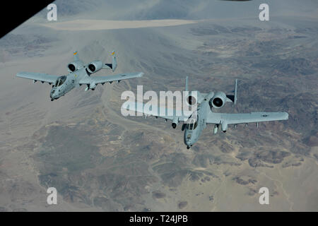Two A-10 Thunderbolt IIs from Davis-Monthan Air Force Base, Arizona, fly over Southern California March 28, 2019 after they were refueled by a KC-10 Extender assigned to Travis Air Force Base, California. The KC-10 also refueled a Boeing E-3 Sentry, offloading more than 19,000 pounds of fuel. All three aircraft will be featured at the Thunder Over the Bay Air Show at Travis March 30-31. (U.S. Air Force photo by Tech. Sgt. James Hodgman) - Stock Photo