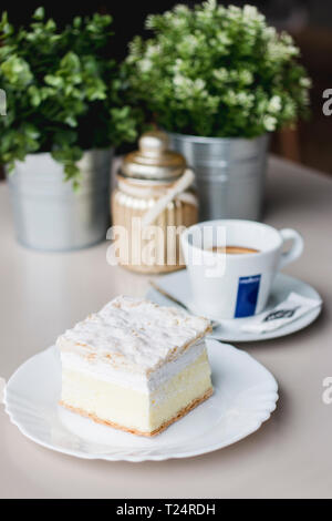 Piece of cake with coffee and nice decorations - Stock Photo