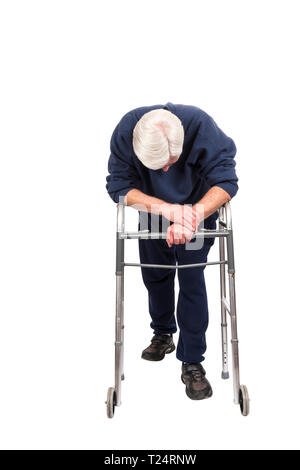 Vertical shot of a tired elderly man resting on his walker with his head down isolated on white with copy space. - Stock Photo