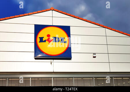 Nowy Sacz, Poland - March 20, 2019: Exterior view of the Lidl Store sign. Lidl is a large German global discount supermarket chain based in Neckarsulm - Stock Photo