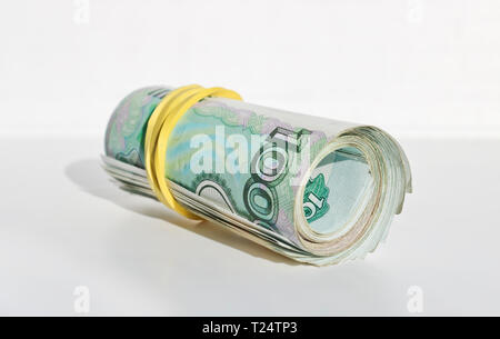 A pack of 1000 ruble bills folded into a tube and intercepted by an elastic band. - Stock Photo