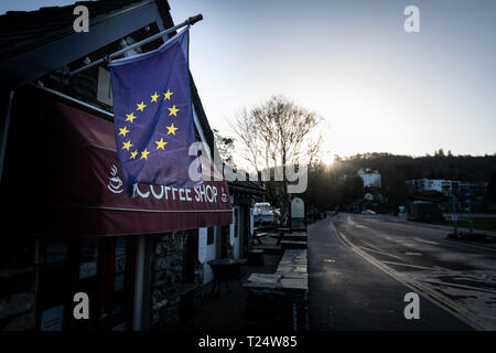 Small local English business fly the EU Flag amid Brexit Crisis in Windermere, Lake District - Stock Photo