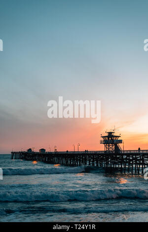 Waves in the Pacific Ocean and the pier at sunset in San Clemente, Orange County, California - Stock Photo