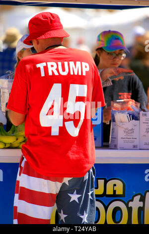 Man dressed from head to toe showing his support for President Trump buys a smoothie at the Tucson Airshow AZ - Stock Photo