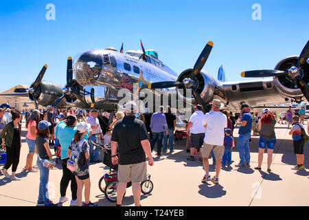 People enjoyng getting up close to a WW2 B17 Flying Fortress bomber named Sentimental Journey at the Tucson airshow in Arizona - Stock Photo