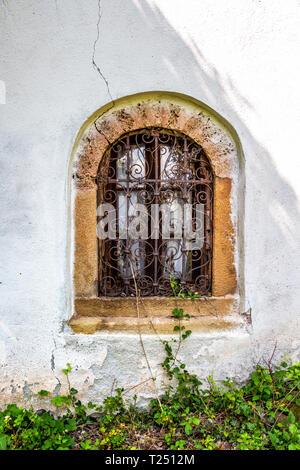 Beautiful window of Holy Trinity Church at the village of Malo Malovo, Dragoman Municipality, Sofia Province, Western Bulgaria - Stock Photo